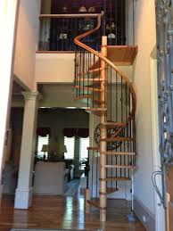 Offers On Laminate Flooring Ivory Wooden Spiral Staircase With Double Black Iron Baluster And