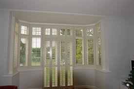 bay window with french door in the centre plantationshutters