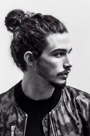 curly hair undercut man bun fade haircut