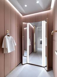 aura home design gallery mirror j m davidson by universal design studio a doorway framed with the