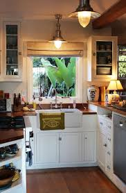 cozy kitchen ideas white cabinets wood counters and a pendant and that sink and
