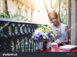 pretty young woman reading book while stock photo 219971110
