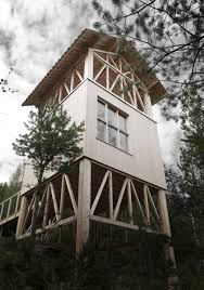 timber framed cabin by hanna michelson stands on stilts to peep