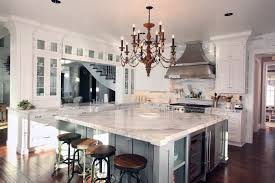 carrara marble kitchen island traditional kitchen with carrara marble by signature design
