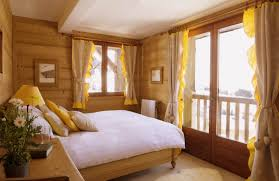 Yellow Room Beautiful Mountain House Small Bedroom Interior Design With Winter Decoration Ideas Small Wooden Master Bedroom Warm Bedroom Design Ideas Jpg