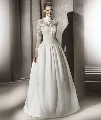 robe de mari e dentelle manche longue robe de mariée princesse col montant avec manches longues en