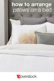 how to place throw pillows on a bed 12 ways to arrange pillows on a bed overstock com