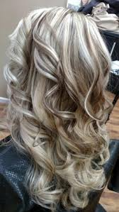 hi and low lights on layered hair cool blonde highlight with rich lowlights mixed throughout hair