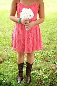 bridesmaid in cowboy boots coral bridesmaid dress wedding