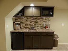 furniture wet bar cabinets with stone backsplash and floating