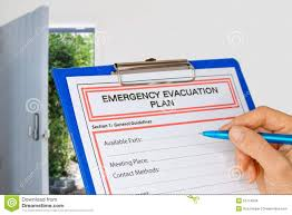 Fire Evacuation Plan Template For Office by Clipboard With Emergency Evacuation Plan Beside Exit Door Stock