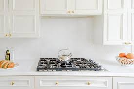 kitchen backsplash with white cabinets and white countertops white cabinets with white quartz backsplash and