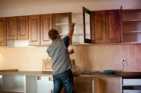 how to hang a cabinet to the wall how to install kitchen cabinets hometips