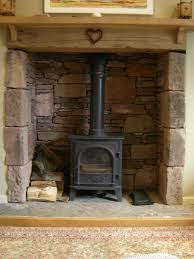 fireplace makeover from brick to natural stone veneer with