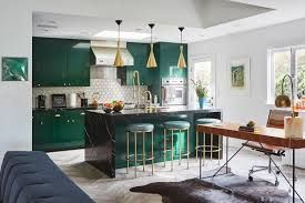 a bachelor embraces color and quirk in the hollywood hills curbed la the emerald green kitchen with brass fixtures and detailing
