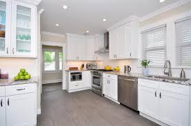 quartz countertops white shaker kitchen cabinets lighting flooring