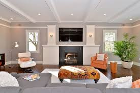 contemporary living room with exposed beam u0026 wall sconce in