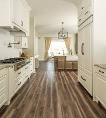 white kitchen cabinets with vinyl plank flooring new luxury vinyl plank flooring in lancaster flor haus