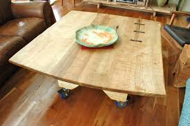 curly maple slab custom dining table with sculpted block base with