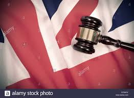 gavel on top of a british flag stock photo royalty free image
