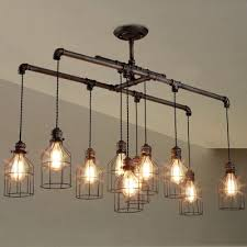 wire guards for light fixtures brushed iron 1 tier linear chandelier with wire guard pinteres