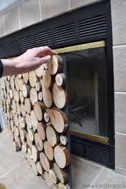 diy tutorial on how to make a faux stacked log fireplace screen
