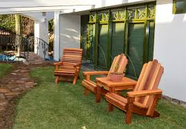 Cushion Settee Adirondack Chairs Joined By Thick Timbered Table