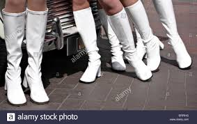 1960 u0027s style models in white boots and union jack mini skirts in