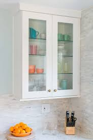 the trick to organizing a kitchen with glass front cabinets