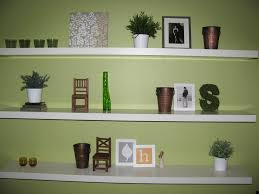 decorating gallery wall with white frames and floating shelves for