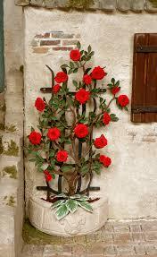 rambling red rose at a half round trellis miniatures 1