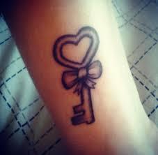 46 om tattoo on wrists