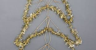holiday diy wall mounted christmas tree made from wire hangers
