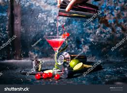 red martini drink barman preparing pouring red cocktail martini stock photo