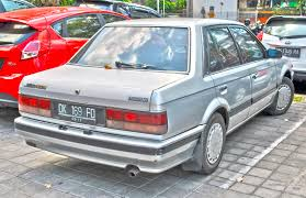 mazda saloon cars file mazda 323 xg s saloon rear denpasar jpg wikimedia commons
