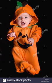 pumpkin costume halloween a baby wearing an orange pumpkin costume alberta canada stock