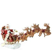 eight tiny reindeer santa claus figurines and carved wooden