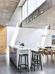 white aluminum screen and in situ concrete create a dramatic kew home