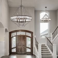 lighting entryway with front entry door and sidelights also