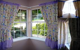 purple pattern curtains with fabric tieback and white steel rod