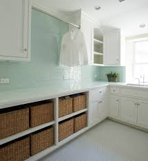 laundry room base cabinets surf glass tile in laundry room open shelves for baskets found at