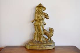antique cast iron woodsman with dog doorstop large