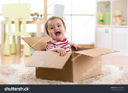 pretty baby infant boy sitting inside stock photo 699995332