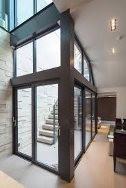 good use of a glass floor to light the basement below basement