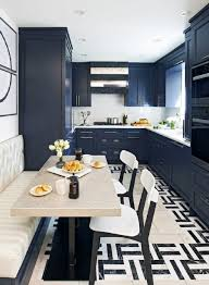 dark blue cabinets white solid countertop beige kitchen banquette