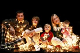 family christmas card with white lights and black background