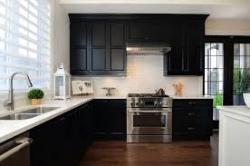 black kitchen cabinets with white subway tile backsplash black cabinets with white subway tile design ideas