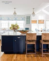 white kitchen cabinets with blue island large blue kitchen island with white cabinets transitional