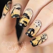 copycat claws sunday stamping wildlife nail art