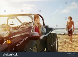 beach jeep clipart caucasian woman sitting jeep on beach stock photo 651141355